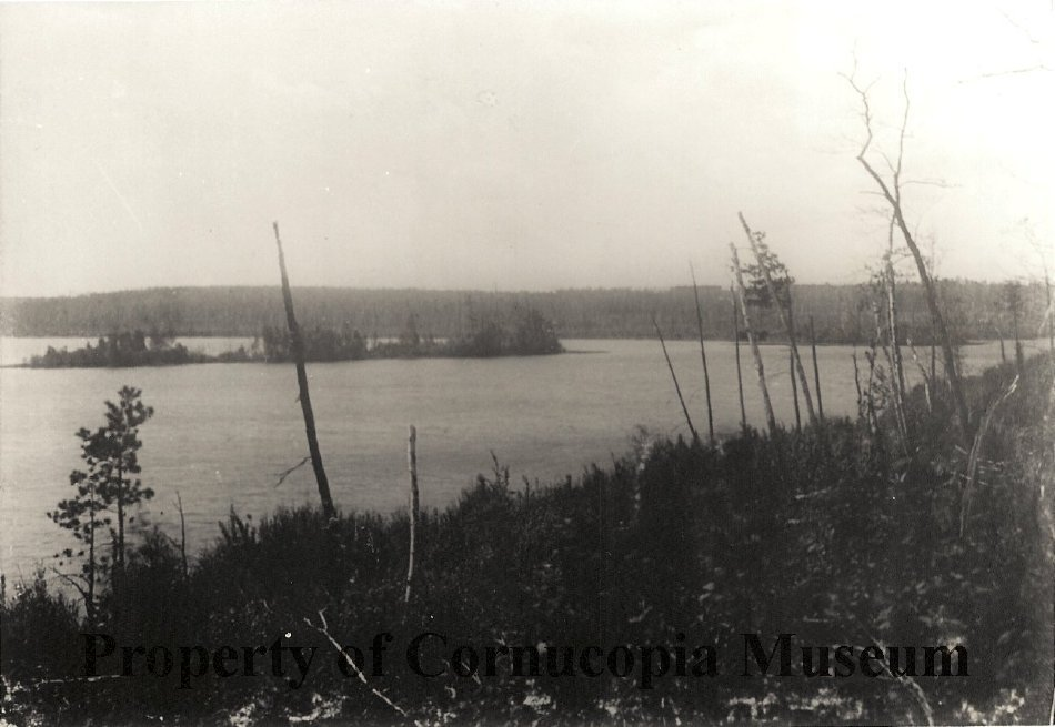 Siskiwit Lake with unnamed island. Photo by Thomas Jefferson Stevenson. Image courtesy of the Historic Green Shed Museum in Cornucopia, WI.