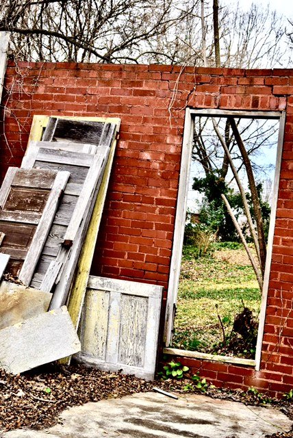 """A Door Left Wide Open. Downtown Wrecked House"" by William C. Crawford, photo"